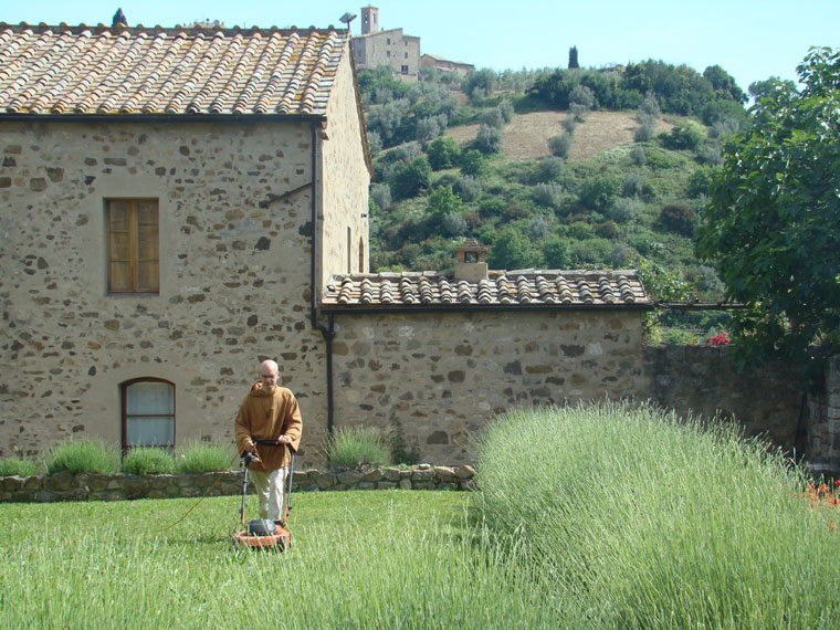 A monk mows his lawn at the Benedictine Abbey in Sant'Antimo