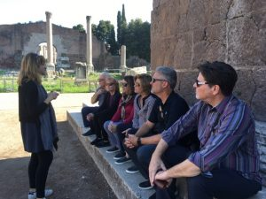 Our guide Paola keeps the group captivated on a day tour in Rome.